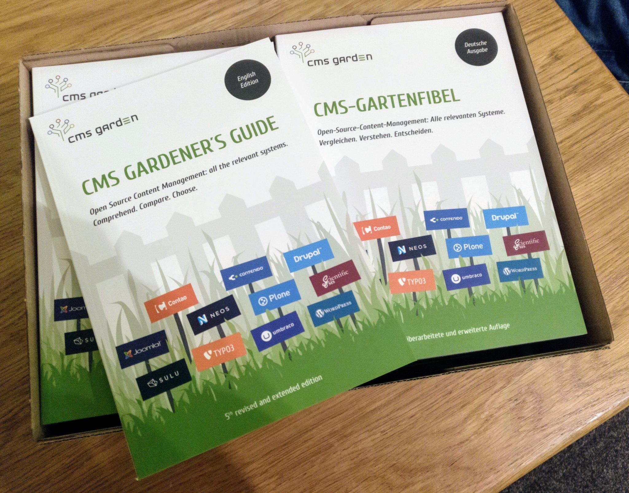 Karton mit Gartenfibeln, Umschlag mit englischsprachigem und - gedreht - deutschsprachigem Titel