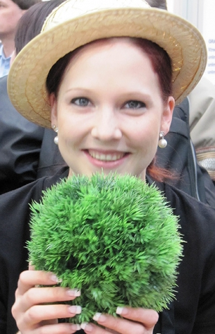 Steffi presenting a fake grass ball